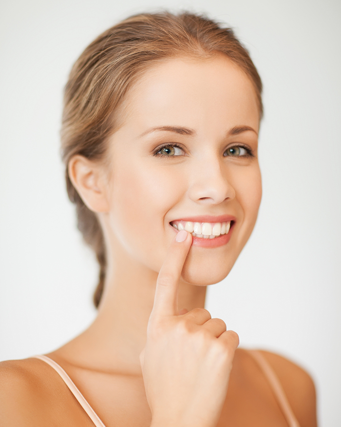 Sorriso mulher jovem Dentista Florianópolis